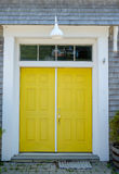Architectural beautiful yellow door to a boat storage garage Royalty Free Stock Photo