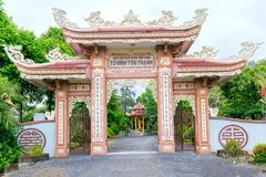 Architectural beauty of ancient temple gate in countryside. Long An, Vietnam - October 15th, 2017: Architectural beauty of ancient temple gate in countryside royalty free stock photography