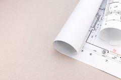 Architectural blueprint and blueprint rolls on desk Stock Photos