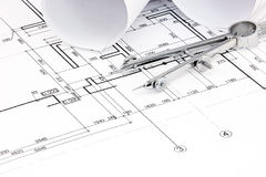 Architectural blueprint plans with rolls and drawing compass Royalty Free Stock Images