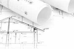 Architectural blueprint rolls and home plan drawing Royalty Free Stock Photos