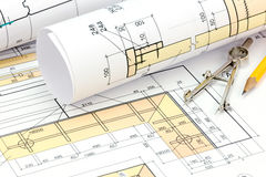 Architectural blueprint rolls with plan and drawing compass Royalty Free Stock Photos