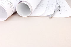 Architectural blueprint rolls with plan and pencil Stock Image