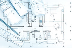 Architectural blueprint rolls with plan, pencil and ruler Stock Photography