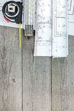 Architectural blueprint rolls with tape measure and folding rule Stock Photos
