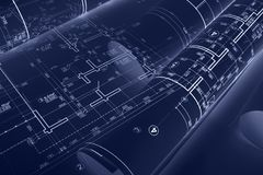 Architectural blueprint rolls and technical drawings on desk. do. Architectural blueprint rolls, technical drawings and sketches on desk. double exposure. blue Royalty Free Stock Images