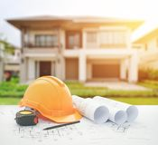 Architectural blueprint with safety helmet and tools over modern building. As background royalty free stock photos