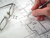 Architectural Blueprints. An architect's workspace with blueprint in progress Royalty Free Stock Photos