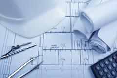 Architectural blueprints, blueprint rolls, compass divider, calc Stock Image