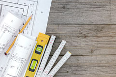 Architectural blueprints with contractor work tools with floor p Royalty Free Stock Image