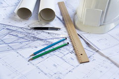 Architectural blueprints. Blueprints, pencils, rulers and a hardhat Royalty Free Stock Photo