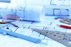 Architectural blueprints rolls and engineering items Royalty Free Stock Images