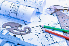 Architectural blueprints rolls and engineering items Stock Images