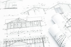 Architectural building plans with rolls Royalty Free Stock Photo