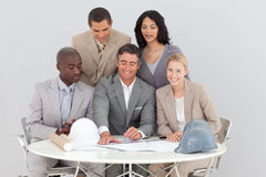 Architectural business people studying plans Stock Images