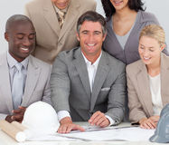 Architectural business team studying plans Stock Photos