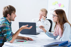 Architectural co-workers during doing job Royalty Free Stock Image