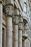 Architectural columns, windows with balcony decorated Egyptian sculptures Royalty Free Stock Photos