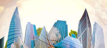 Architectural composition made of corporative buildings. Abstract business background Stock Photos