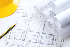 Architectural construction plans. With pencil and hardhat on it royalty free stock photo