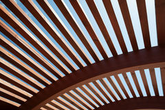 Architectural construction of wooden slats. Modern architectural construction of wooden slats with half-round, openwork design Royalty Free Stock Images