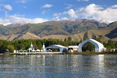 Architectural constructions on the bank of mountain lake. Kyrgyzstan . Lake Issyk-kyl.Pure mountain lake. Summer Royalty Free Stock Photo