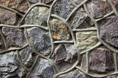 Architectural decor. Architectural decor of a facade of the house from granite stones Stock Images