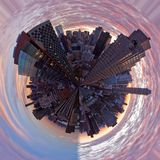 Architectural Density. This globe (little planet) was generated from a panorama of NYC skyline from 70th and York.  The sky is supposed to emphasize the Royalty Free Stock Photos