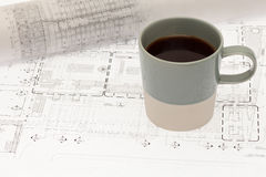 Architectural design with coffee cup Stock Images