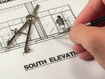Architectural Design & Tools. An architect designs drawings for new construction using various implements Stock Images