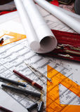 Architectural desk. Various drawings and drafting tools royalty free stock images