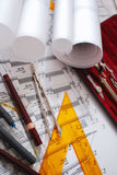 Architectural desk. Various drawings and drafting tools royalty free stock image