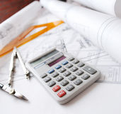 Architectural desk. Various drawings, calculator and drafting tools stock photo
