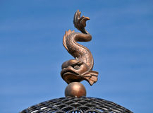 Architectural detail. Fish dancing on a sphere and waved a tail Stock Photography