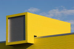 Architectural detail. Yellow architectural detail against blue sky Royalty Free Stock Photo