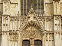 Architectural detail of Brussels Cathedral with arch and statues of saints Royalty Free Stock Image
