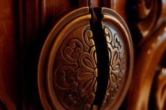 Architectural detail. Carved wooden element on the door. Stock Image
