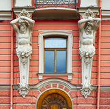 Architectural detail of facade in neo-Baroque style with figures of Atlantes Stock Photos