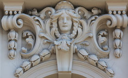 Architectural detail on the facade of an old building, Zagreb, Croatia. Architectural detail with a mascaron of a young woman set on top of a column on the stock images