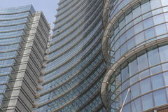 Architectural detail of the glass facade on the Unicredit tower building in Milan. MILAN, ITALY - MAY 10 2014: Architectural detail of the glass facade on the royalty free stock image