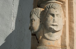 Architectural detail heads on a wall Stock Photos