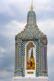 Architectural detail on an intricately decorated tower at the Grand Palace in Bangkok, Thailand Stock Photos