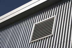 Architectural detail of a metal clad building. Geometric pattern on a metal clad building Royalty Free Stock Images