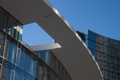 Architectural detail of modern building. Against blue sky Stock Photos
