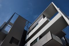 Architectural detail of modern building. Against blue sky Stock Image