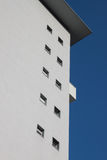 Architectural detail of a modern building. Architectural detail of a modern against blue sky Stock Photos