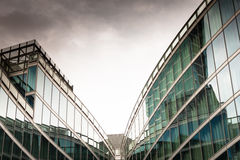 Architectural detail of a modern building. With dark sky on background Royalty Free Stock Images