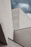 Architectural detail of a modern building. With dramatic sky Royalty Free Stock Photos