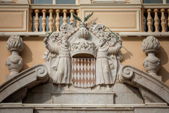 Architectural detail with Monaco coat of arms - Royal Arms of Pr Stock Photos