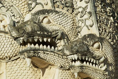 Architectural detail of the Naga mythological Giant snake at the 15th century Prasat temple in Chiang Mai, Thailand. Royalty Free Stock Photography